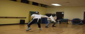 Fencing students practicing.